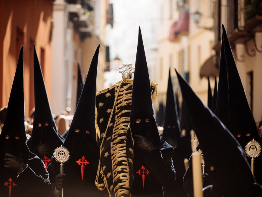 Penitents of 'La Carretería' Brotherhood taking part in processions during Semana Santa (Holy Week), Seville, Andalucia, Spain