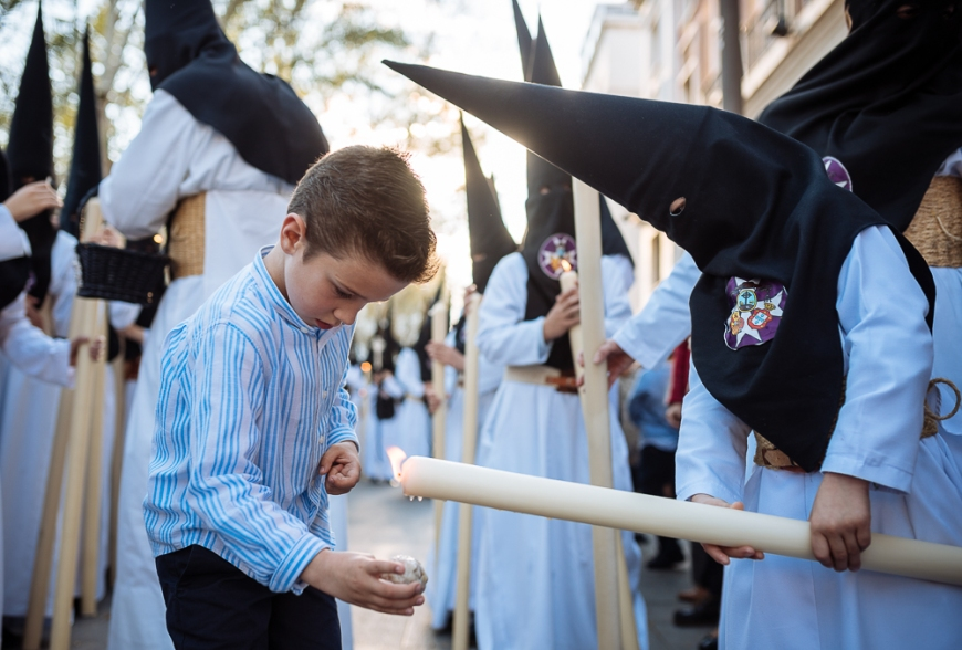 Penitents of 'La Soledad de San Buenaventura' Brotherhood taking part in processions during Semana Santa (Holy Week), Seville, Andalucia, Spain