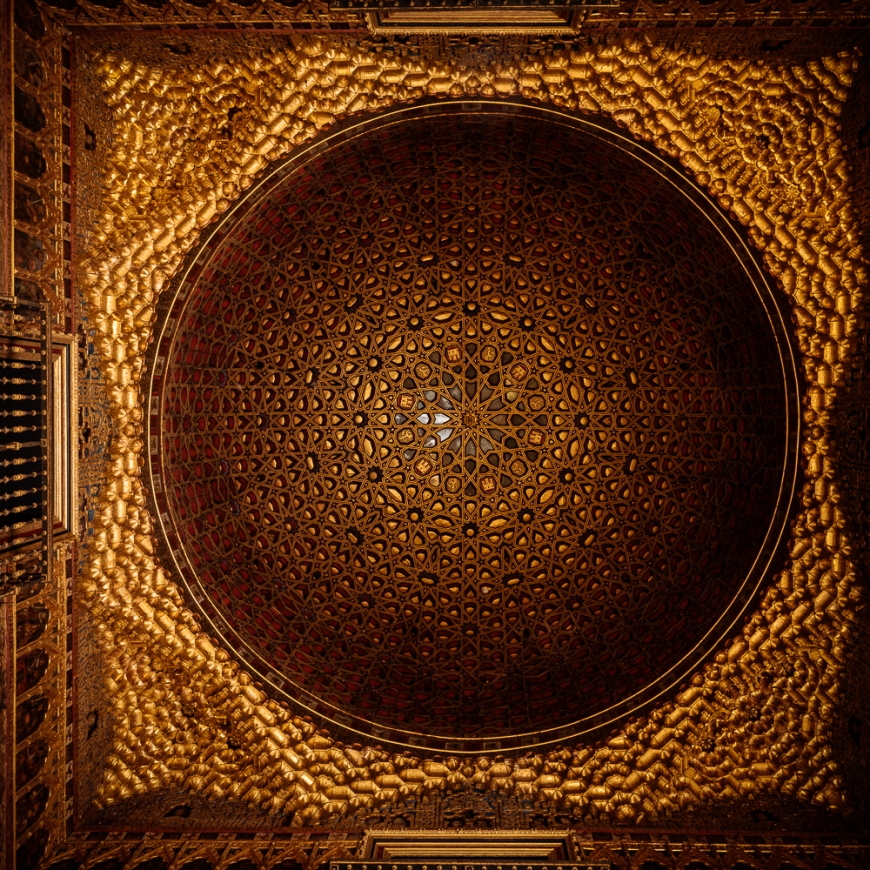 Intricately carved wooden ceiling atof The Royal Alcázar (Palace) of Seville, Seville, Andalucia, Spain
