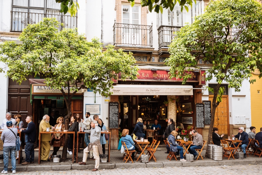 People sitting outside restaurants, Seville, Andalucia, Spain