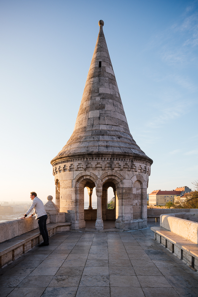Man watching sunrise from Fisherman's Bastion, Budapest, Hungary