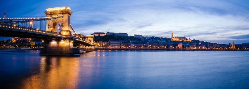 View across Danube River of Chain Bridge & Buda Castle at night, Budapest, Hungary