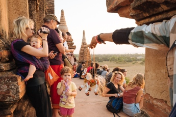 Tourists enjoying the sunset from Temple, Bagan, Mandalay Region, Myanmar