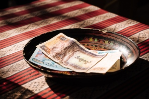 View of Myanmar currency on restaurant table, Bagan, Mandalay Region, Myanmar