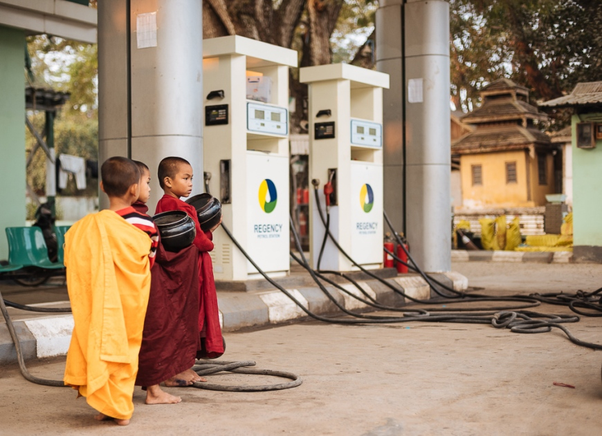 Young Novice monks waiting for alms at petrol station, Hsipaw, Shan State, Myanmar, Asia