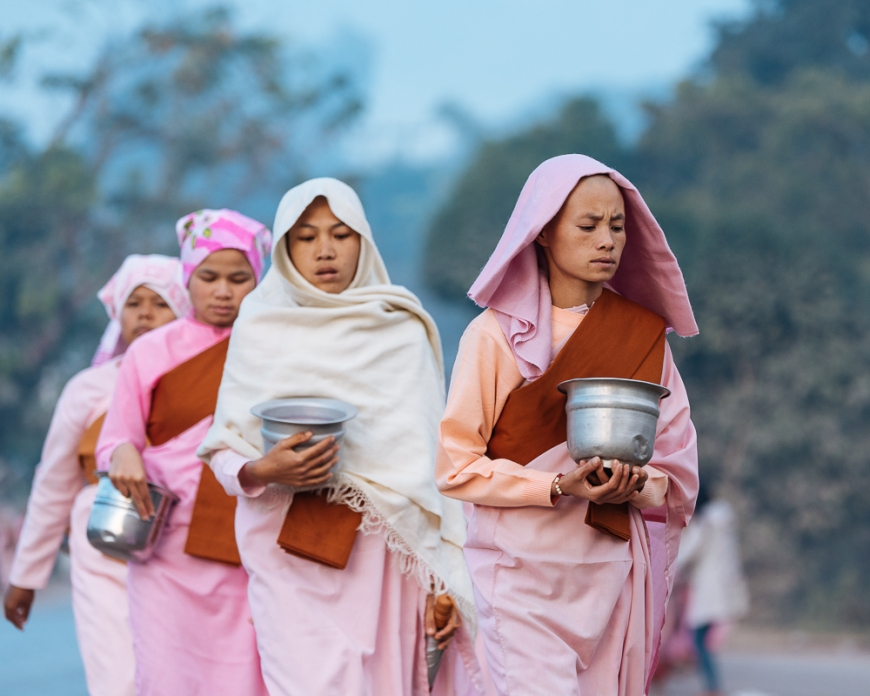 Buddhist nuns collecting alms in the early morning near Hsipaw, Shan State, Myanmar