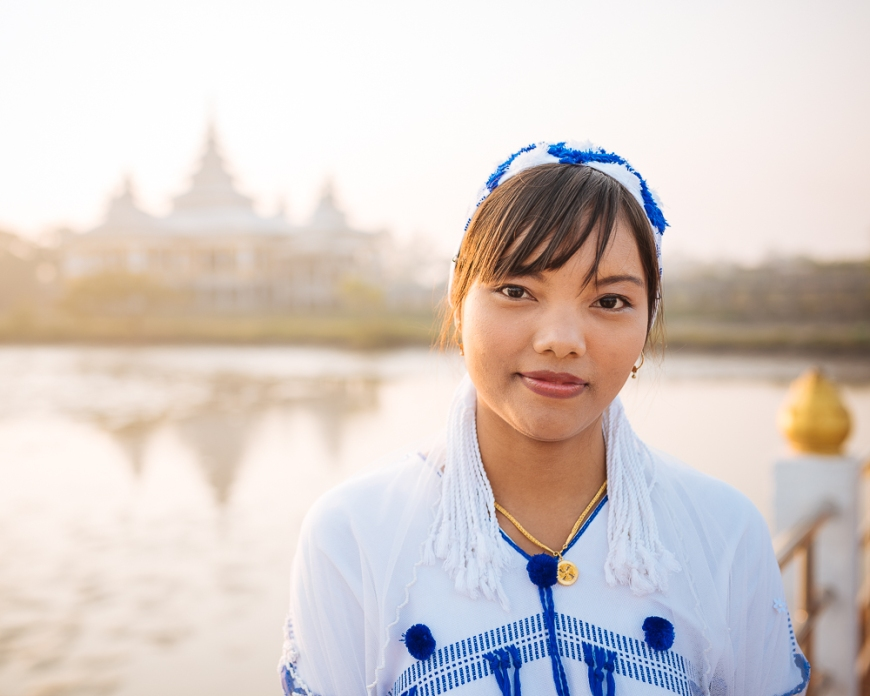 Portrait of Bride on her Wedding day as she visits temple for blessing before the wedding ceremony, Kyauk Ka Latt Pagoda, Hpa-an, Kayin State, Myanmar