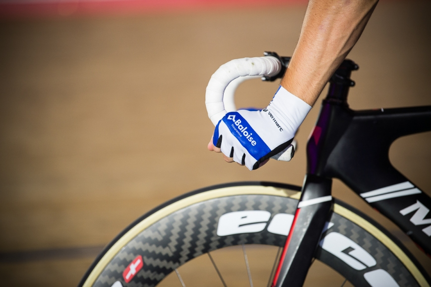 Detail of gloves on handlebars, Six Day Cycling at The Velodrome, London. October 2017 Nikon D4 with Nikon 70-200mm Lens at 190mm. Exposure: 1/125th at f/2.8 and ISO 1250