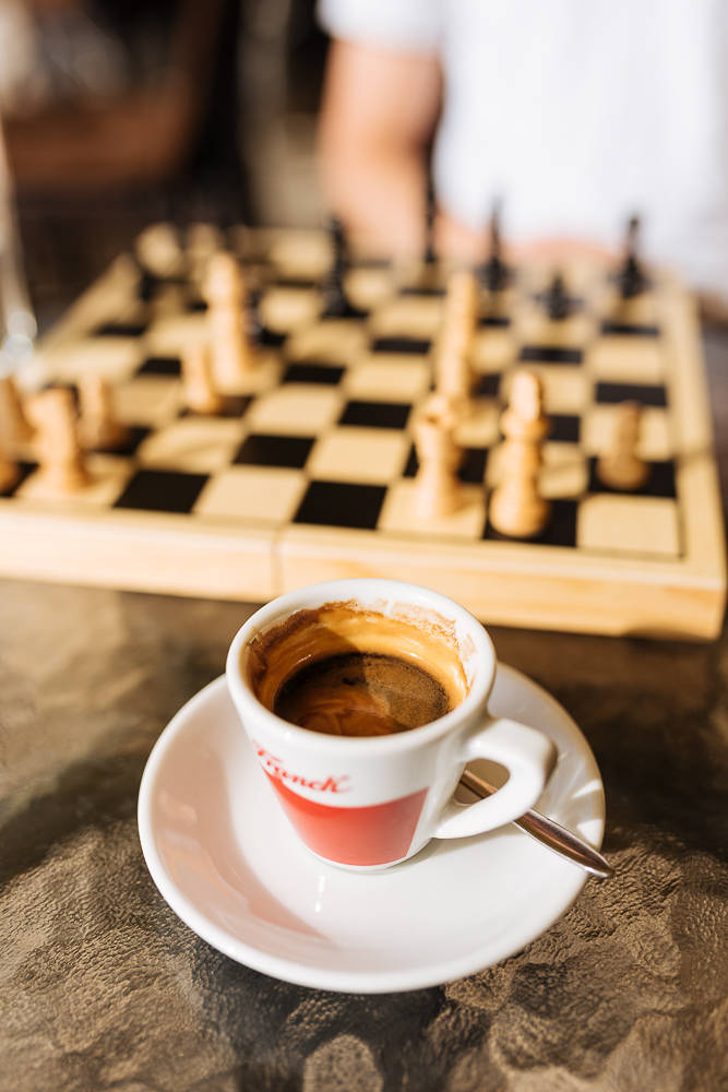Espresso with chess set in background, Old Town, Sarajevo, Bosnia
