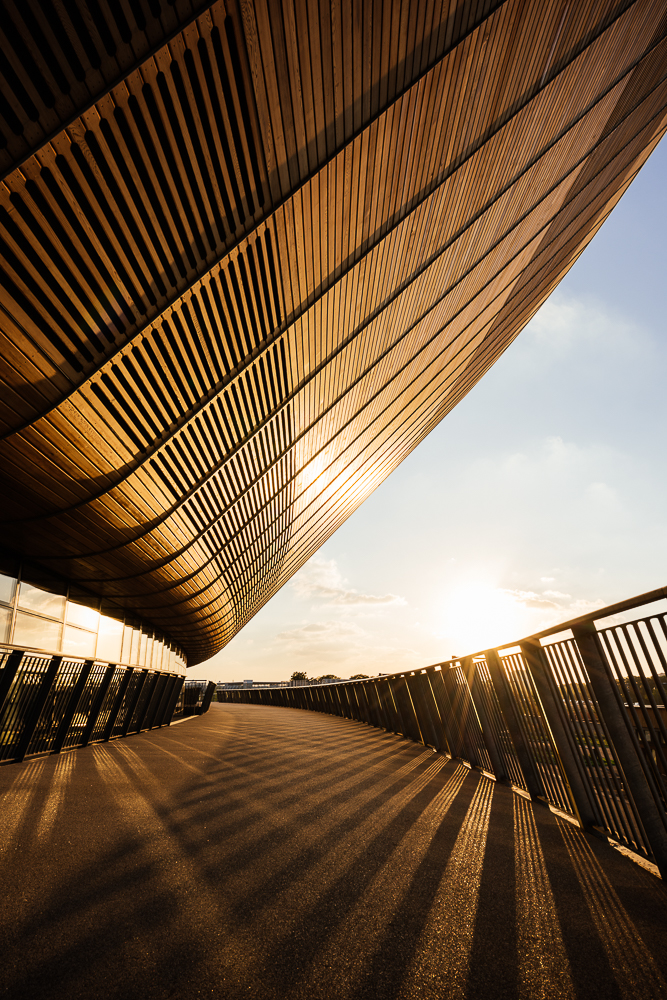 Evening light on exterior of The Velodrome, Queen Elizabeth Olympic Park, Stratford, London, UK