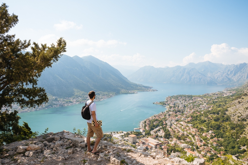 Young man enjoying view from the Town Walls, Kotor, Bay of Kotor, Montenegro