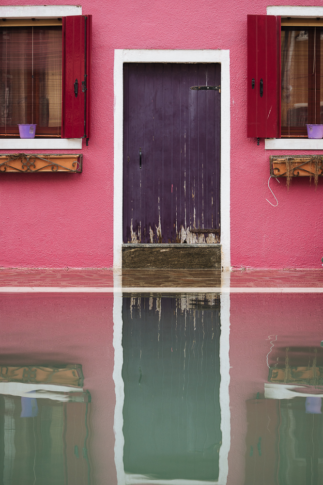 Reflections of house in canal water, Burano, Veneto Province, Italy, Europe