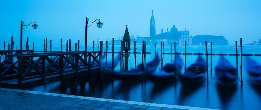 Gondolas on the waterfront of St Mark's Basin with San Giorgio Maggiore in the background at dawn, Venice, Veneto Province, Italy, Europe