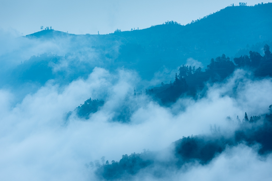 Mist over mountains after sunrise, Duoyishu, Yuanyang, Yunnan Province, China