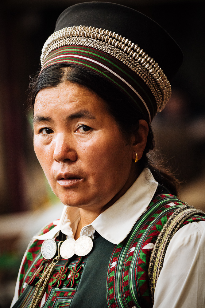 Portrait of traditionally dressed local woman, Xinjie Local Market, Yuanyang, Yunnan Province, China
