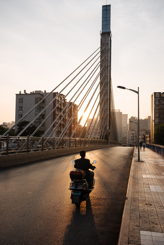Sunrise behind modern bridge, Kunming, Yunnan Province, China