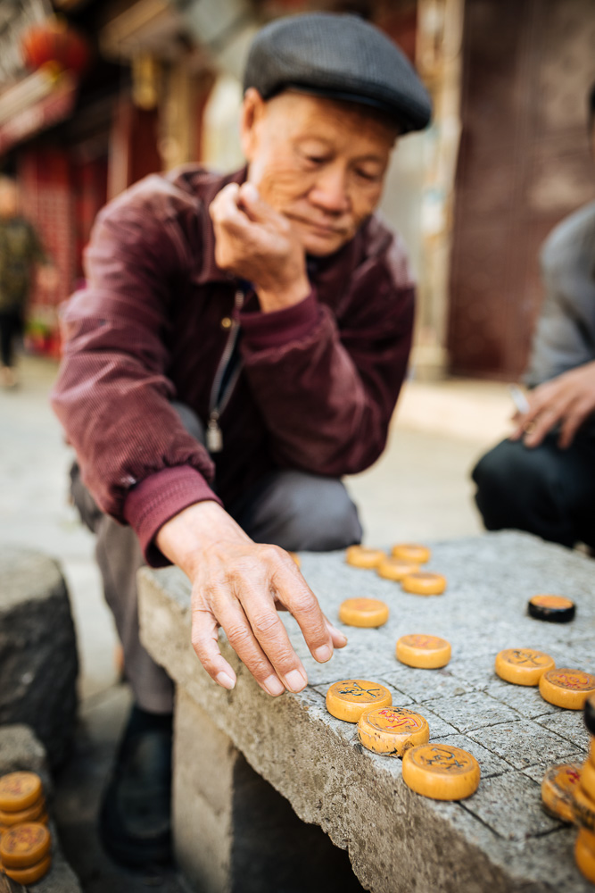 Men playing traditional game of Xiangqi (Chinese Chess), Dali, Yunnan Province, China