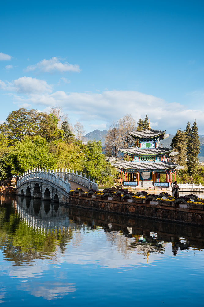 Moon Embracing Pavilion and bridge, Black Dragon Pool Park with Yulong Xueshan (Jade Dragon) Mountain, Lijiang, Yunnan Province, China