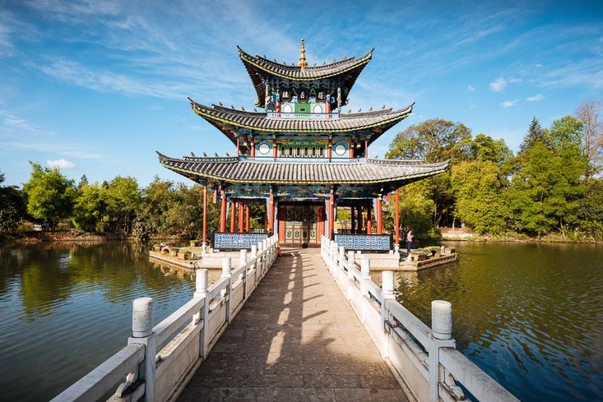 Moon Embracing Pavilion and bridge, Black Dragon Pool Park with Yulong Xueshan (Jade Dragon) Mountain, Lijiang, Yunnan Province, China