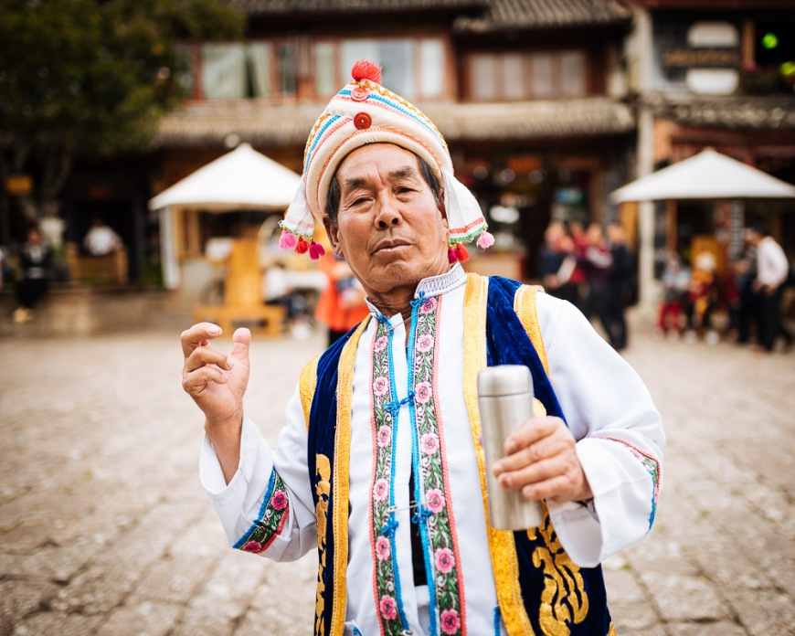 Portrait of man in traditional clothing, Lijiang, Yunnan Province, China