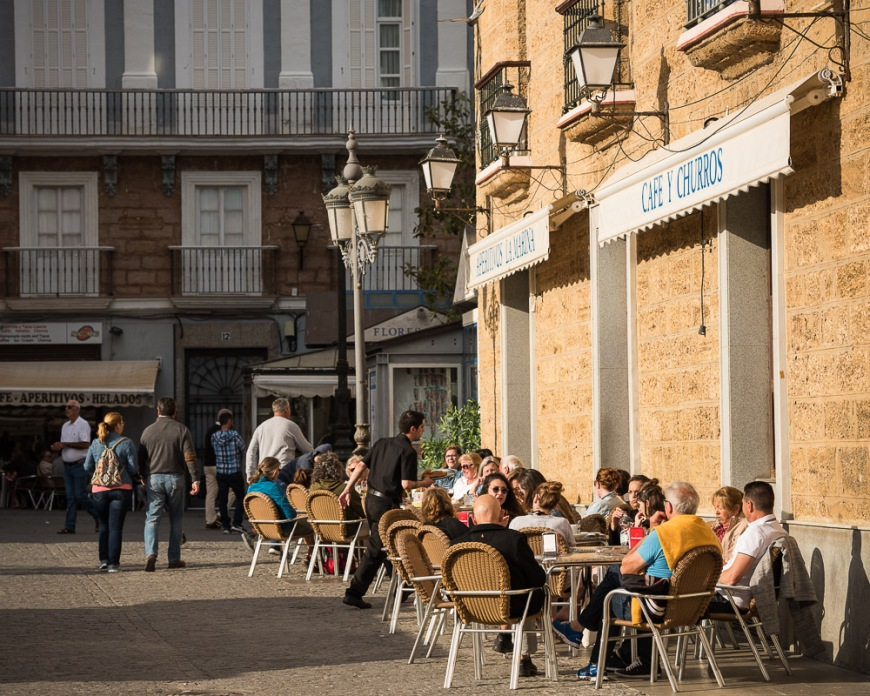 People sitting outside cafe, Cadiz, Andalucia, Spain