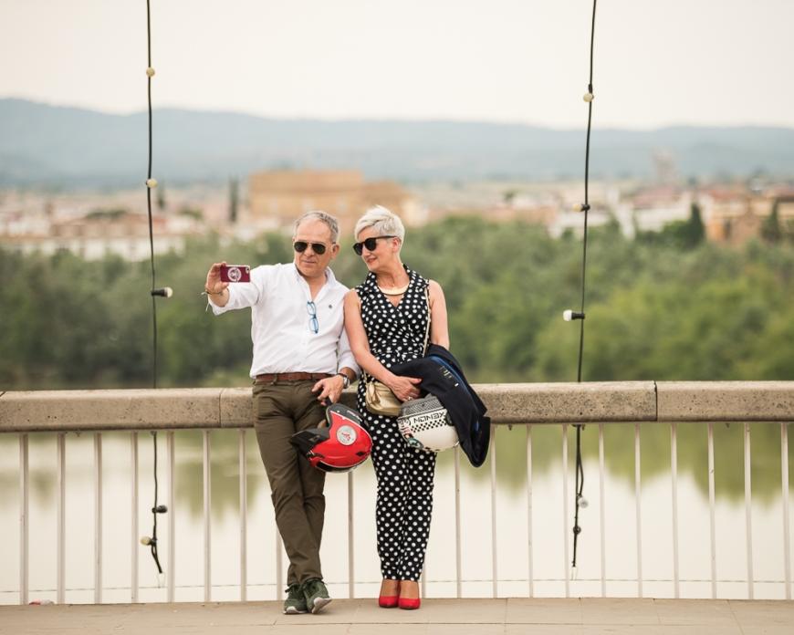 Couple taking selfie on bridge, Cordoba, Andalucia, Spain