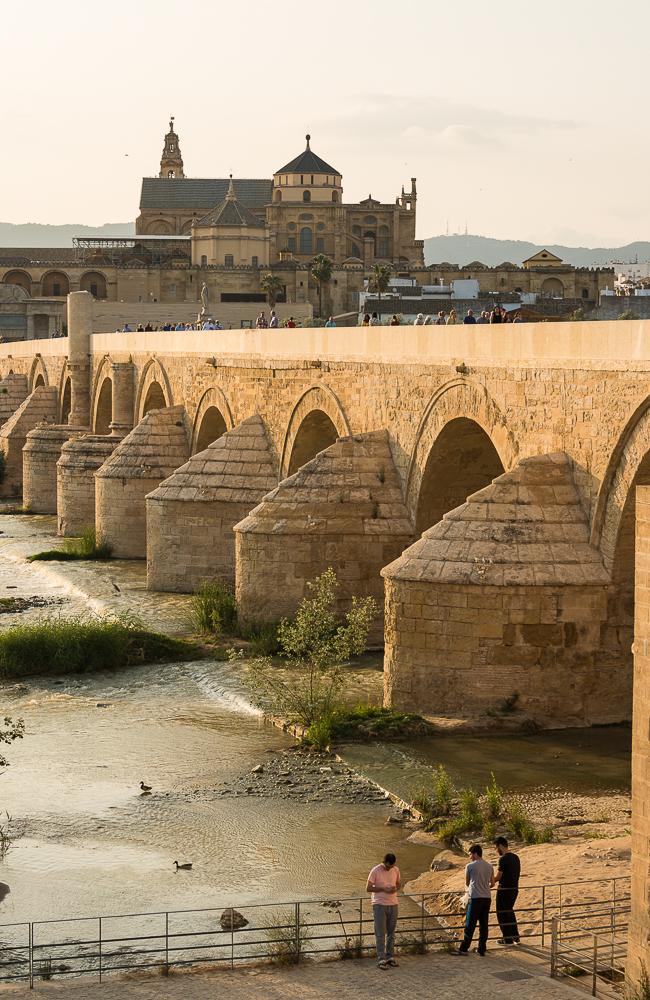 The Cathedral and former Great Mosque of Córdoba (Mezquita de Córdoba) and Roman Bridge (Puente Romano) over the Guadalquivir River, Cordoba, Andalucia, Spain