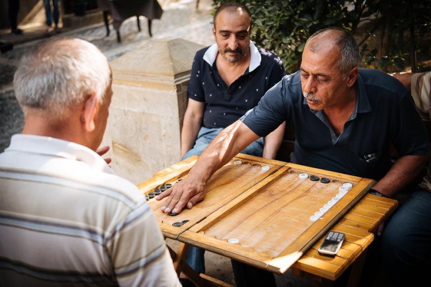 Men playing Backgammon in Old Town, Baku, Azerbaijan