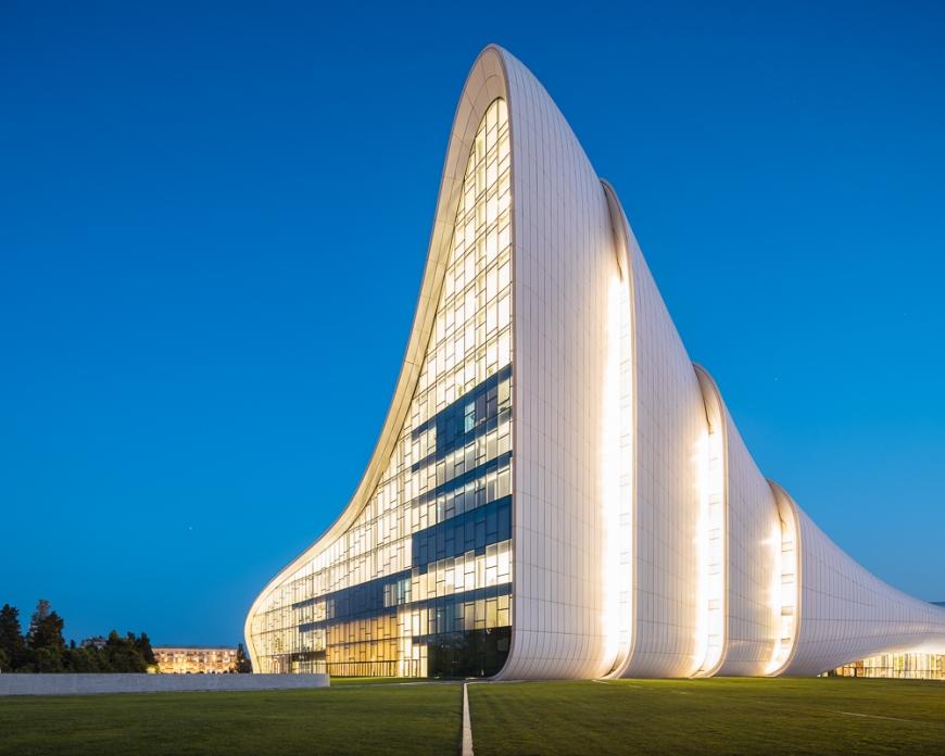 Exterior of Heydar Aliyev Building at night (designed by Zaha Hadid), Baku, Azerbaijan