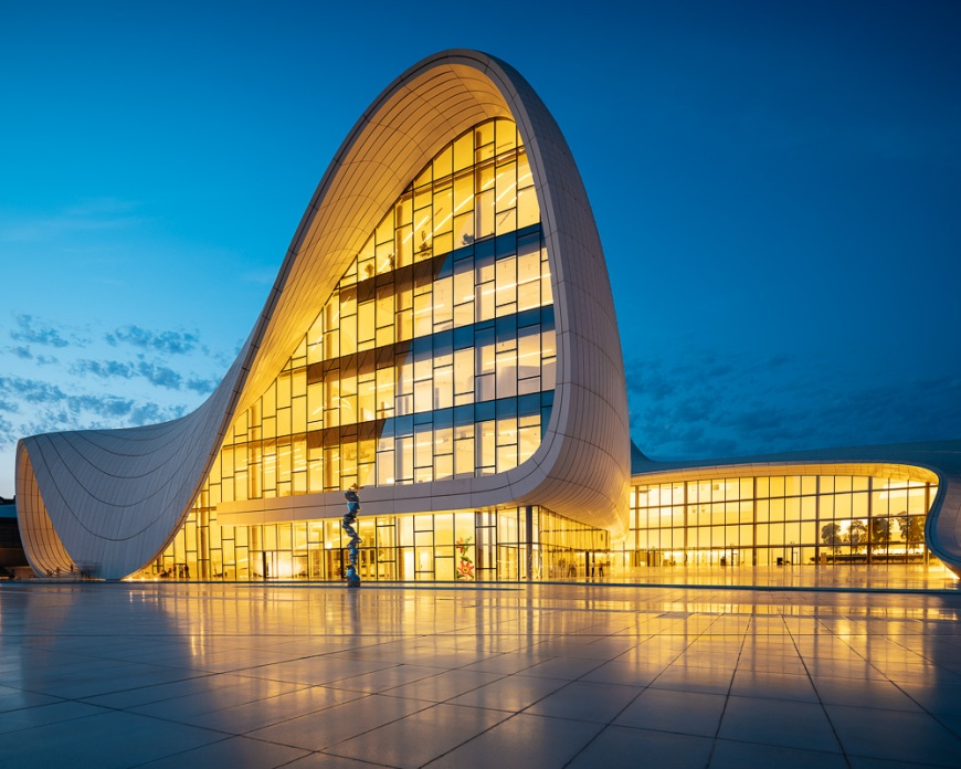 Exterior of Heydar Aliyev Building at night (designed by Zaha Hadid), Baku, Azerbaijan