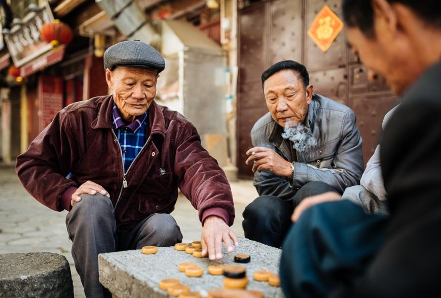 Men playing traditional game of Xiangqi (Chinese Chess), Dali, Yunnan Province, China