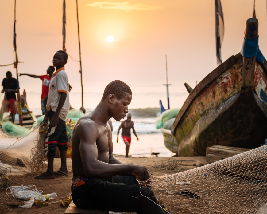 Fishermen fixing nets, Cape Coast, Ghana, Africa