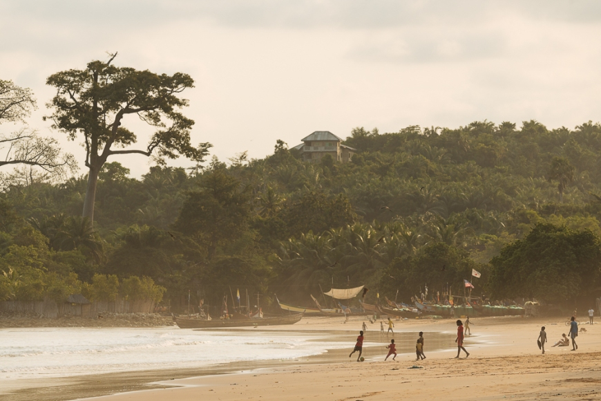 Children playing football on beach, Busua, Ghana, Africa
