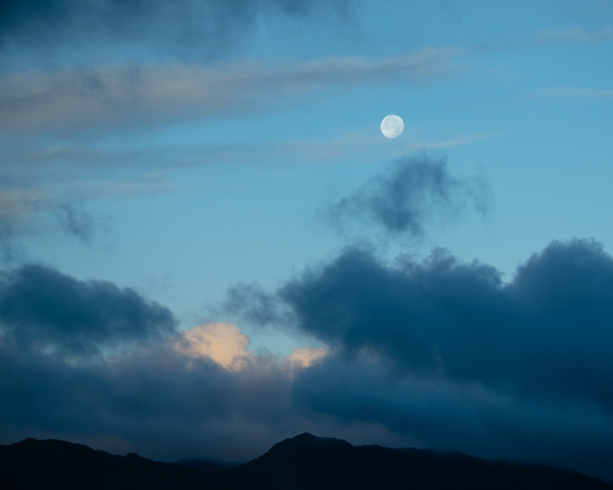 Full moon setting from Loughrigg Fell, Lake District, Cumbria, England, United Kingdom