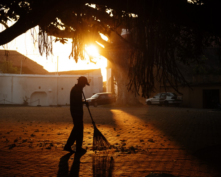 Man sweeping ground at dawn, Galle, South Coast, Sri Lanka, Asia