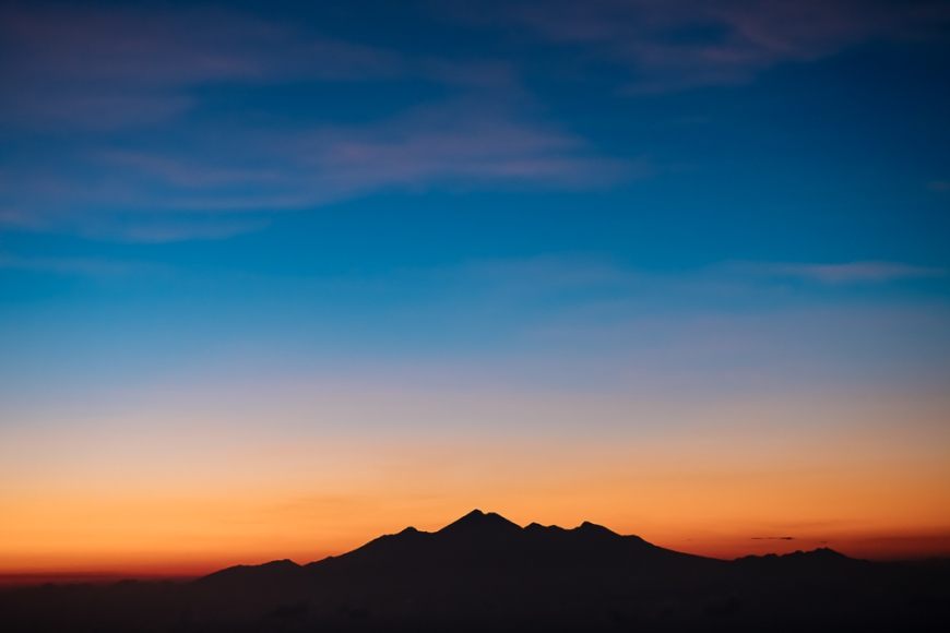 View from Summit of Mount Batur of Mount Rinjani at dawn, Batur, Bali, Indonesia