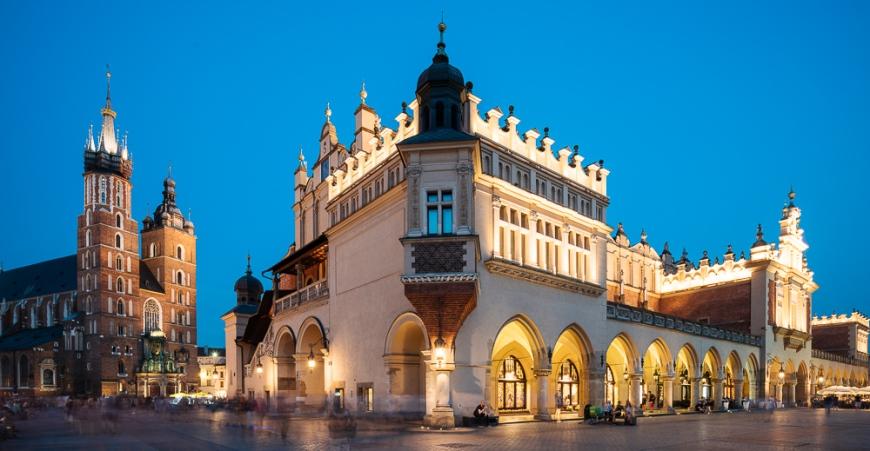 Exterior of Saint Mary's Basilica (Bazylika Mariacka) in Market Square (Rynek Glowny) at night, Krakow, Malopolskie, Poland, Europe